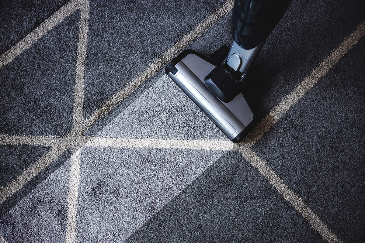 vacuuming a rug after cleaning