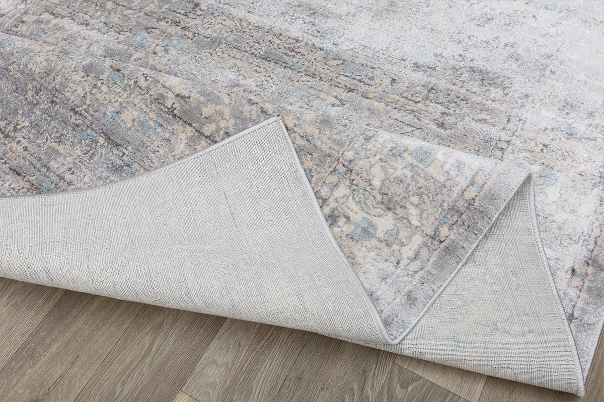Folded underside of a bespoke rug